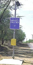 An emergency call box located in a rural area is mounted in an accessible location and can be used with or without speech to provide effective communication.