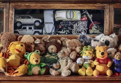 His collection of teddy bears and model cars. His room is filled with the stuff.
