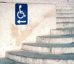Sign at an inaccessible entrance provides directions to the nearest accessible entrance