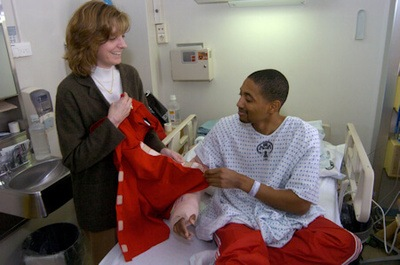 Ginger Dosedel, founder of Sew Much Comfort*, visits with arriving patients April 6 at Ramstein Air Base, Germany. Sew Much Comfort is an all-volunteer nonprofit organization that designs adaptive clothing for wounded and injured servicemembers. (U.S. Air Force photo/Master Sgt. Chuck Roberts).