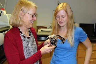 Andrea Dietrich, Virginia Tech professor of civil and environmental engineering, discusses the licorice odor that can linger in drinking water with one of her graduate students, Amanda Sain. Photo Credit: Virginia Tech