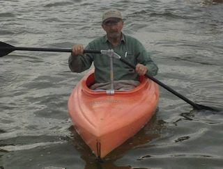 Jim Van Gompel Using the Angle Oar in an Orange Kayak