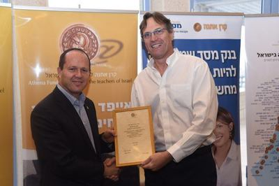 Jerusalem's Mayor Nir Barkat (left) and Uri ben Ari, President and Founder of Athena Fund, at the launching ceremony of the distribution of iPads to special education teachers in Jerusalem.