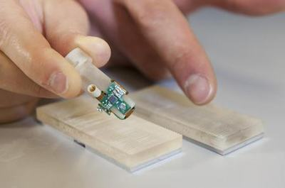 Detail of the bionic fingertip electronics that restored sensations of texture to amputee Dennis Aabo Sorensen, and the plastic gratings with rough and smooth textures - Picture Credit Hillary Sanctuary / EPFL