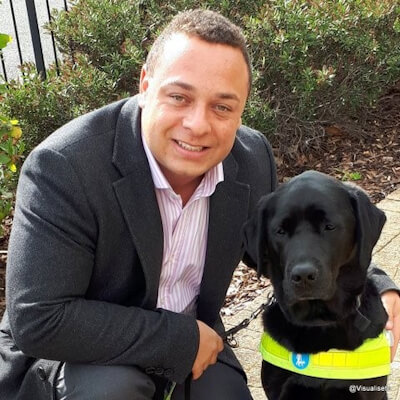 Close up photo of Daniel Williams and his assistance dog Zodiac.