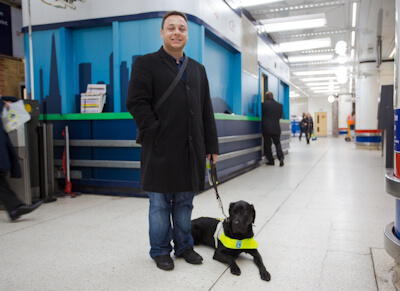 Daniel Williams and Zodiac, his assistance dog, at the U.K. Rail Network.