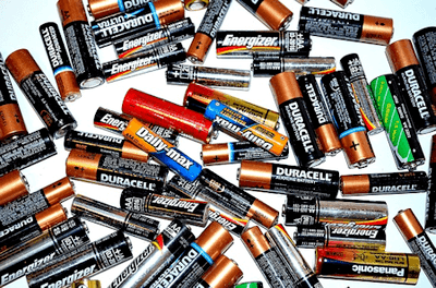Assortment of AA and AAA Alkaline batteries as used in household items such as toys, electronics etc.