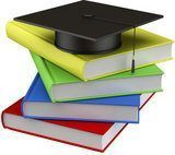 Stack of books with graduation hat