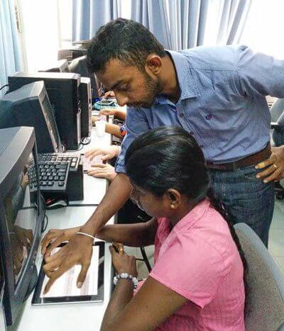 A touchscreen Braille app undergoes testing in Sri Lanka. (Courtesy Sohan Dharmaraja.)