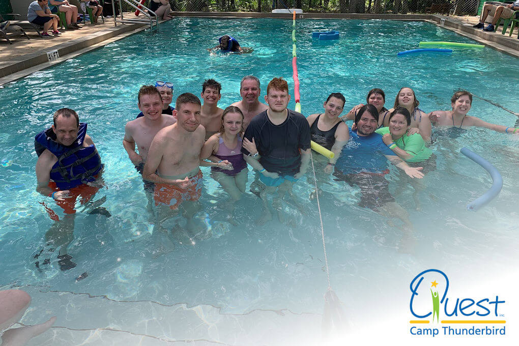 A group of people enjoying the swimming pool at Camp Thunderbird.