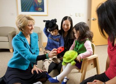 Professor Robin Hansen, left, with children at the UC Davis MIND Institute. Photo Credit: University of California Regents