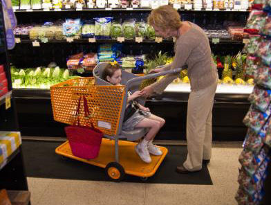 "CAROLINE'S CART SHOPPERS Drew Ann Long grocery shops with her daughter, Caroline, who sits comfortably in ""Caroline's Cart."""