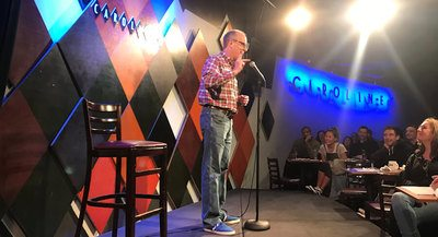 "Tom Willard entertains the crowd at Caroline's on Broadway in New York, Dec. 3, 2018.  He was invited to perform in Caroline's' New Talent Showcase, featuring ""the country's top up-and-coming comedians."""