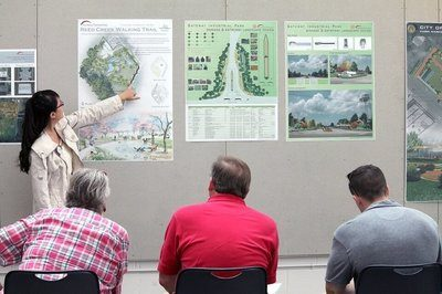 Tianyi Jiang, a master's of landscape architecture student, explains the disability camp walking trail project she completed for Metter/Candler County.