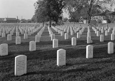 Black and white picture of headstones in a cemetery