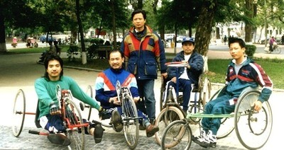 Members of the Vietnam hand cycle team in the 1998 Vietnam Challenge. World T.E.A.M. Sports archive photograph.