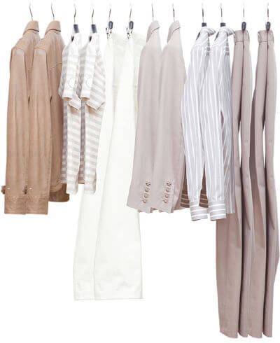 Brown and white adaptive clothing items hanging on a clothes rack.