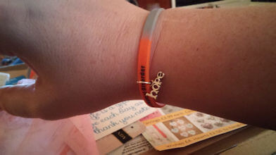 Gray and orange Conversion disorder bracelet.