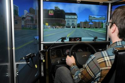 Using a driving simulator, researchers at Massachusetts Eye and Ear/Schepens Eye Research Institute set out to determine the extent to which people with hemianopia can compensate for the lost vision when driving, with a long term goal of developing and evaluating devices and training that will assist them to drive more safely. Photo Credit: Mass. Eye and Ear/Schepens Eye Research Institute
