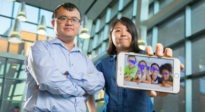 From left to right, Wenyao Xu, University at Buffalo assistant professor of computer science and engineering, and undergraduate Kun Woo Cho, show a smartphone with the autism tracking software they are developing. The purple blotches show where a child looks. This photo indicates no autism spectrum disorder. Photo Credit: Douglas Levere.