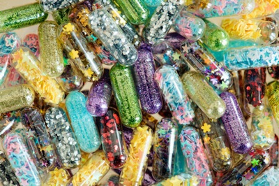 Assorted psychedelic colored capsules - Photo by rawpixel on Unsplash.