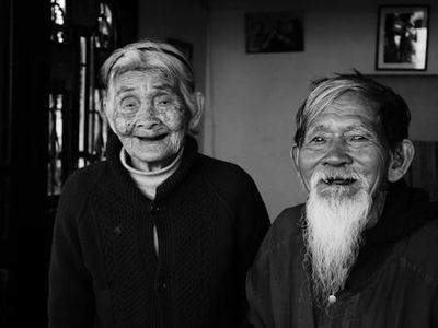 Black and white photo of elderly Asian couple, Mr Le Van So and Mrs Nguyen Thi Loi, who are still very much in love after 70 years of marriage - Photo by Steve Knutson on Unsplash.
