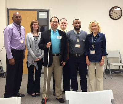 Photo shows Elton Thomas with members of the St. Louis County, Missouri, Board of Elections.