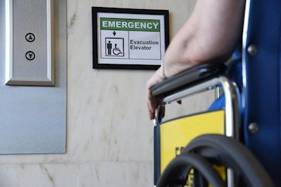 A new NIST study with findings based on the concerns, insights and opinions of people with mobility impairments voiced during interviews provides guidance for helping them get safely out of multistory buildings during emergencies, including the use of special evacuation elevators. Image Credit J. Stoughton/NIST