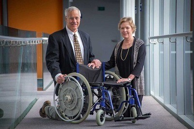 Fig 1. Dr Rory Flemmer and Dr Claire Flemmer with the Ezy-wheels wheelchair design. Photo Credit: Massey University.