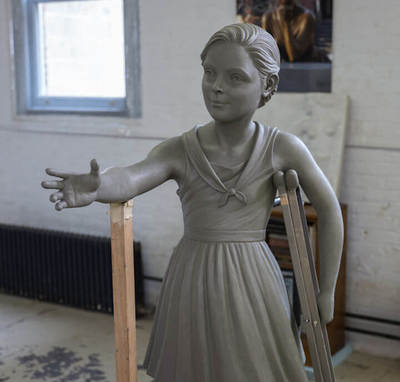 Photo of clay girl sculpture
