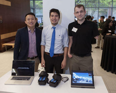 Johns Hopkins biomedical engineering grad students, from left, Adam Li, Nhat (Nate) Tran and Gyorgy (George) Levay displayed their innovative video gaming shoes at a recent design competition. Photo by John Bidlack/homewoodphoto.jhu.edu