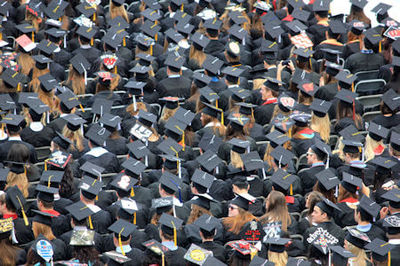 Overhead view of a crowd of graduates wearing graduation hats - Photo by Good Free Photos on Unsplash.