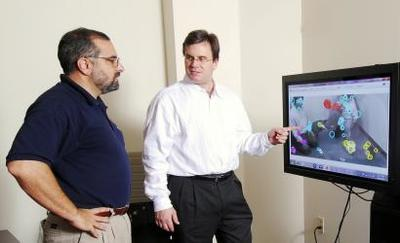 Gregory Abowd (left) and James Rehg, professors in Georgia Tech's School of Interactive Computing, received a $10 million grant to develop novel computing techniques for measuring and analyzing the behavior of children. (Georgia Tech Photo: Gary Meek)