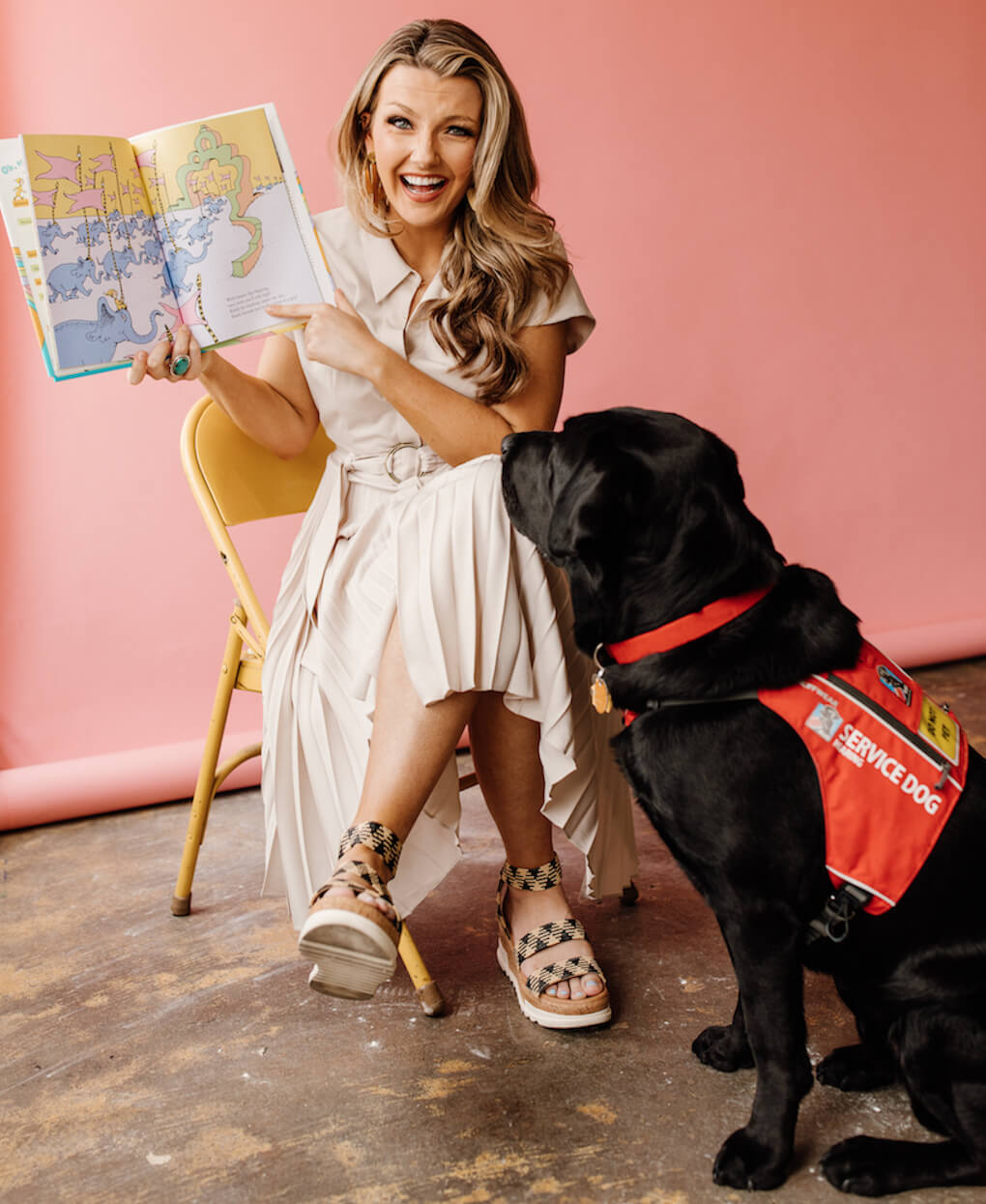 Emma Faye Rudkin is former Ms. San Antonio and Founder and Executive Director of Aid the Silent. She works alongside her hearing dog, Hank. Photo Credit: Devin Travieso.