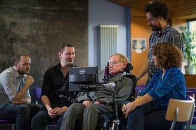 Professor Stephen Hawking with the team who worked on his new Intel-powered communications system: Steven Spencer, SwiftKey; Joe Osbourne, SwiftKey; Jonathan Wood, Hawking's personal assistant; and Lama Nachman, Intel. Photo: Intel