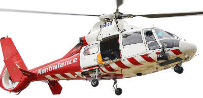 Red and white Air Ambulance helicopter in operation