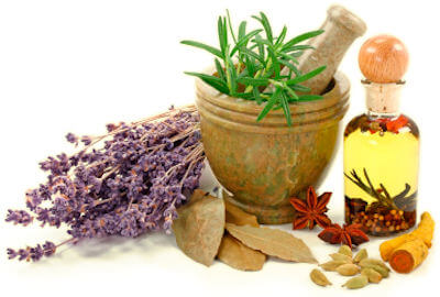 Image depicts various herbs and spices in a mixing bowl and oil bottle.