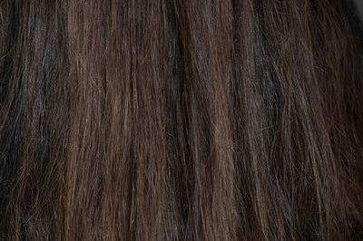 Close-up image of brown colored long straight hair.