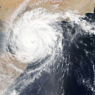 Overhead satellite view of a hurricane (Cyclone) approaching landfall.