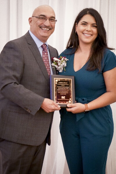 (Pictured) Lieutenant Irwin Rosenberg, LAPD, presenting Gabriela Milian, ABC7, with an award for her great job as Master of Ceremonies!