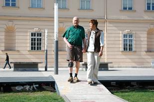 Man wearing MyGait device holding hands with a woman