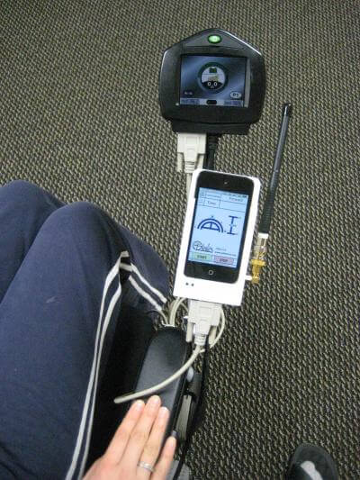 Georgia Tech researchers designed this universal interface for the intraoral Tongue Drive System that attaches directly to a standard electric wheelchair. The interface boasts multiple functions: It not only holds the iPod, but also wirelessly receives the sensor data and delivers it to the iPod, connects the iPod to the wheelchair, charges the iPod, and includes a container where the dental retainer can be placed at night for charging