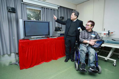 Dr. Eric Tam and a wheelchair user demonstrate controlling curtain movement with iWheelchair - Photo Credit: The Hong Kong Polytechnic University