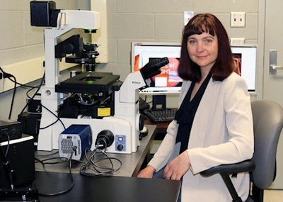 Julia Busik, a Michigan State University physiology professor, is the first to find that a particular type of lipid, or fat, thought to only exist in the skin, now lives in your eye and might play a major role in deterring diabetic retinopathy - Photo Credit: Michigan State University.