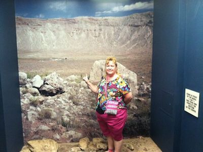 Image of Kat in front of a picture of Meteor Crater