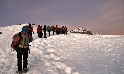 Members of World T.E.A.M. Sports January 2007 Return to Kilimanjaro expedition near the summit. Photograph by Arthur Chivvis.