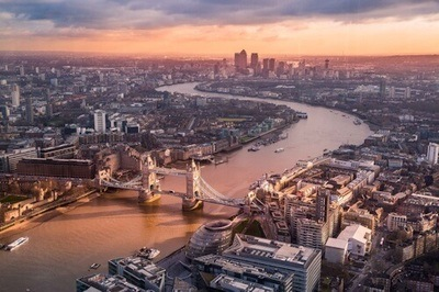 Aerial view of sunrise over London Bridge - Image Credit: Luca Micheli on Unsplash.