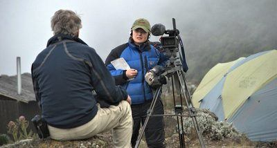 A team member is interviewed on the mountain for the Elevation documentary film. Photograph by Arthur Chivvis.