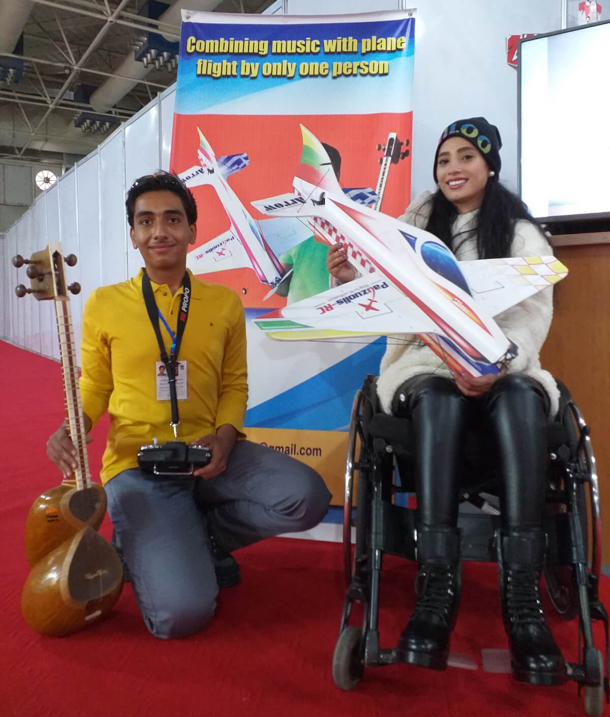 Ali Asgari shows Ms. Niloufar the joy of flying model aircraft. Ali hopes they can perform a formation flight together in the future. His dream is to introduce model airplane flying to people with disabilities.