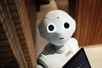 Robot named Pepper holding an iPad - Photo Credit: Alex Knight on Unsplash.